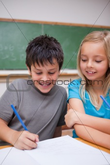 Portrait of happy pupils working together