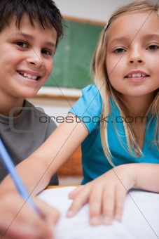 Portrait of two children writing