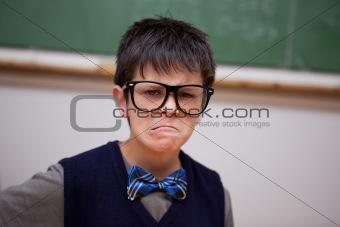 Grumpy schoolboy posing