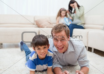 Dad and son lying on the carpet