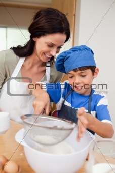Mother and son baking