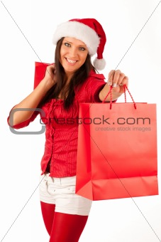 beautiful girl dressed like Santa with Christmas presents