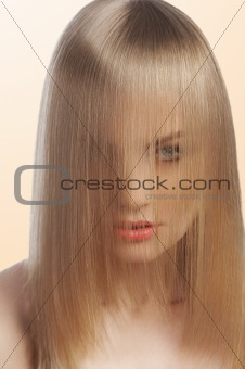 close up of  fashion girl covering face with hair