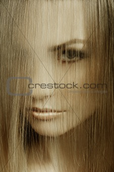 close up of woman covering face with hair