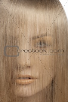 portrait of woman covering face with hair