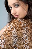 Young woman in animal print dress