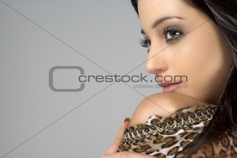 Portrait of young woman in animal print dress