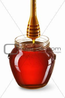 Jar of honey and dipper