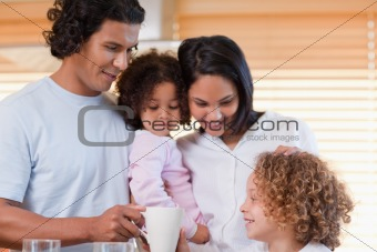 Family enjoys having breakfast together