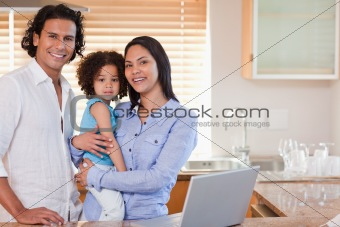 Family surfing the web in the kitchen together