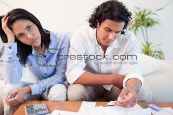 Sad couple checking their bills