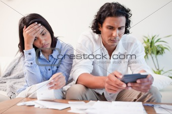 Couple checking bills
