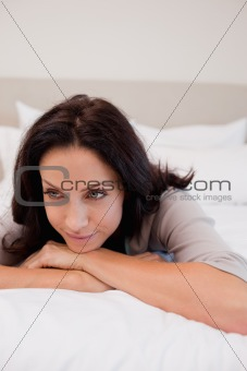 Thoughtful woman on the bed