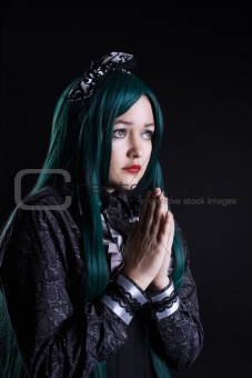 girl cosplay anime character pray in dark