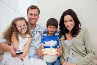 Family watching a movie together