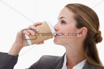 Businesswoman drinking a takeaway coffee