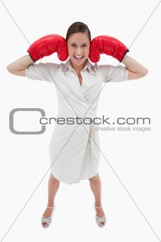 Portrait of a businesswoman with boxing gloves
