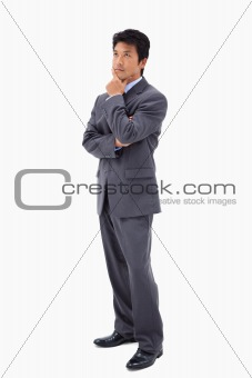 Portrait of a thoughtful businessman with the arms crossed
