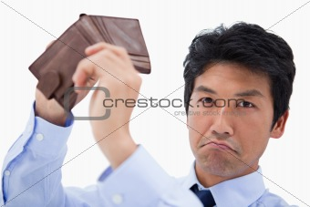 Businessman showing his empty wallet
