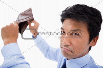 Broke businessman showing his empty wallet