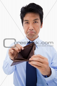 Portrait of a businessman showing his empty wallet