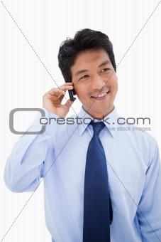 Portrait of a businessman making a phone call