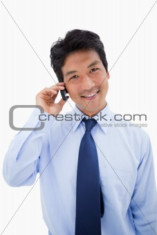 Portrait of a smiling businessman making a phone call