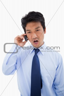 Portrait of an angry businessman making a phone call