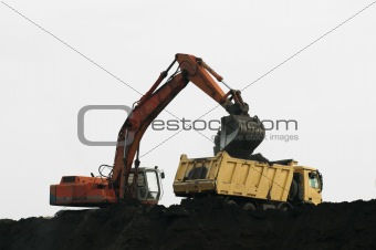 Excavator loading truck