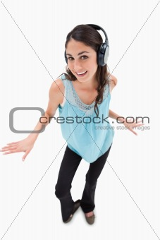 Portrait of a cheerful woman dancing while listening to music