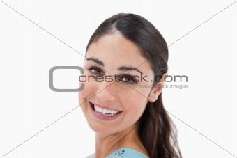 Close up of a young woman smiling at the camera