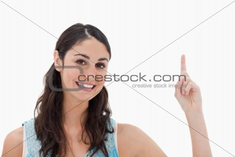 Woman pointing at a copy space