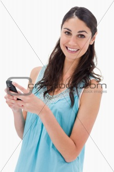 Portrait of a happy woman reading a text message
