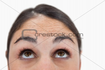 Close up of a woman looking above her