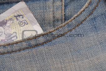 Five Pound Note in Jeans Pocket.