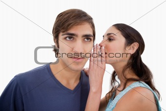 Woman whispering something to her fiance
