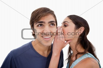 Charming woman whispering something to her fiance