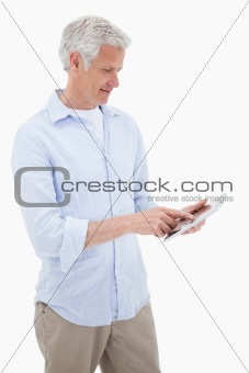 Portrait of a mature man using a tablet computer