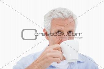 Mature man drinking tea