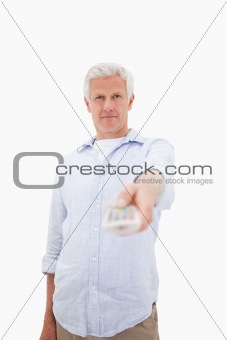 Portrait of a mature man switching of channel
