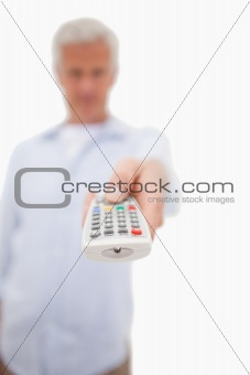 Portrait of a man switching of channel