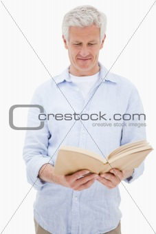 Portrait of a man reading a book