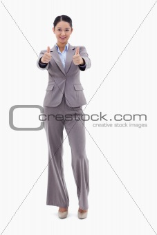 Portrait of a businesswoman posing with the thumbs up