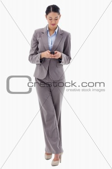 Portrait of a brunette businesswoman sending a text message