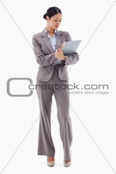 Portrait of a businesswoman taking notes