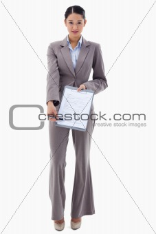 Portrait of a smiling businesswoman showing a contract