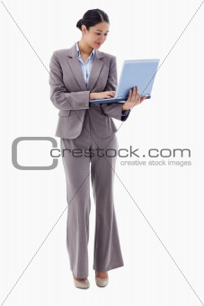 Portrait of a businesswoman using a laptop