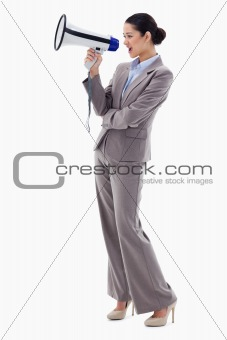 Portrait of a businesswoman shouting through a megaphone