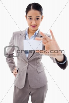 Portrait of a gorgeous businesswoman showing a blank business card