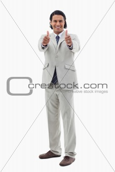 Portrait of an office worker posing with the thumbs up